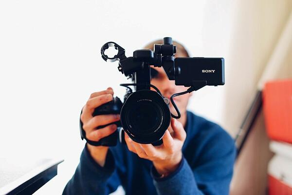 man creating an explanatory video for marketing purposes